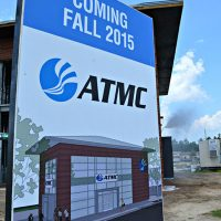 Sign posted in front of ATMC building showing a final rendering