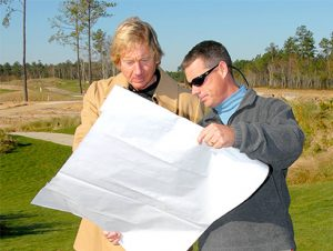 Course Designer Tim Cate looking at course plans with someone