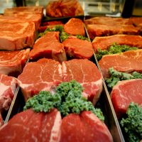 Close up of some steaks inside of Lowes Foods