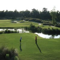 Two Golfers teeing off at Cape Fear National