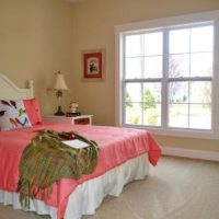 A guest bedroom in the Nantucket II at Brunswick Forest
