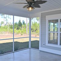 The screened porch of the Newport II at Brunswick Forest