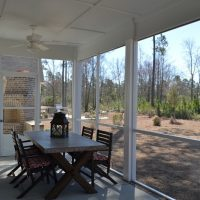 The screened porch of the Kensington at Brunswick Forest