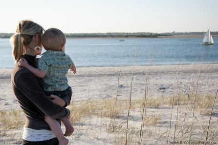 A women and child at the beach at Holden Beach near Brunswick Forest