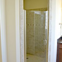 Walk-in shower in the master bathroom of the Hamilton Bay at Brunswick Forest