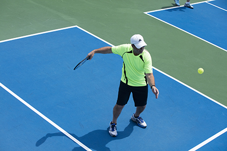 Man serving in Pickleball