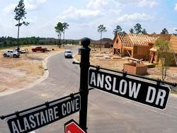 Streets signs of Alastaire Cove and Andslow Dr