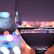 Close up of wine glass with city in background