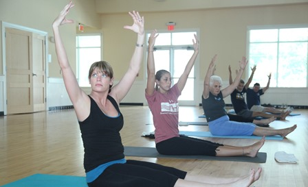 People doing yoga at the Fitness Center
