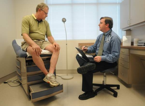 Patient listens to doctor at the New Hanover Regional Medical Center