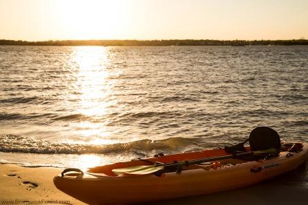 kayak on beach during sunrise