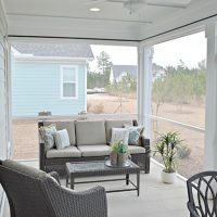 The screened porch off the back of the Blue Heron II at Brunswick Forest