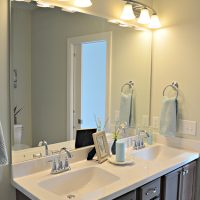 A double vanity in the guest bath of the Blue Heron II at Brunswick Forest