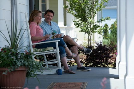 Couple sitting on porch at Brunswick Forest